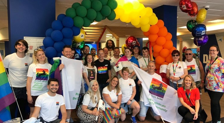 Lloyds banking group celebrating pride with balloons