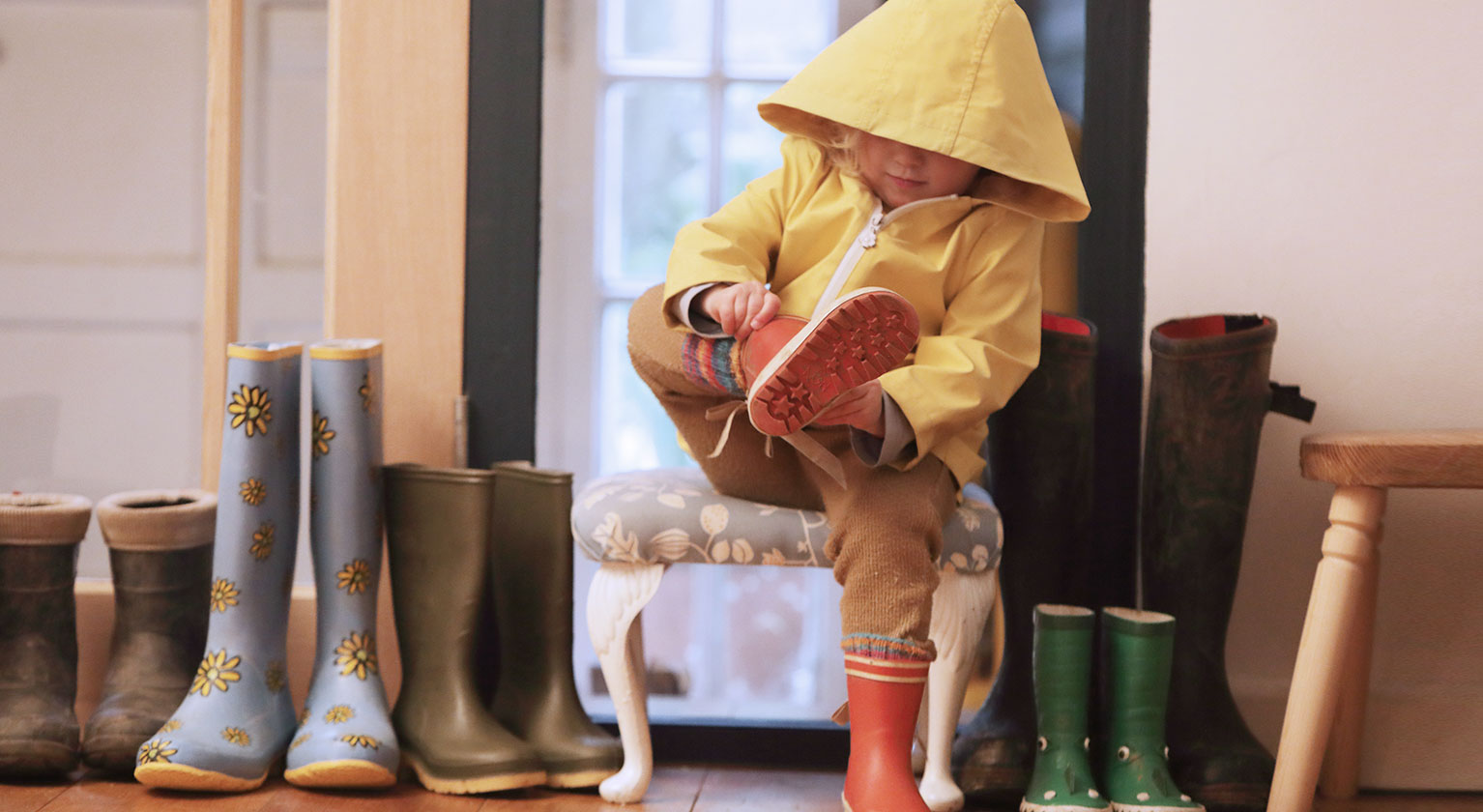 Child putting on wellies